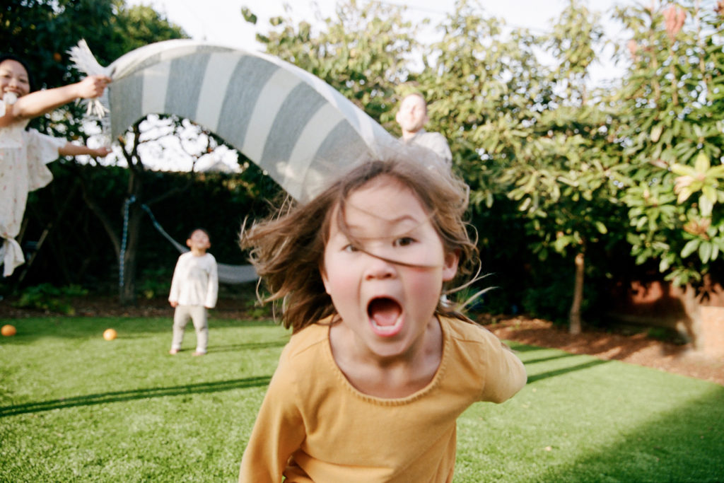Los Angeles family photography on film : family running and playing in yard at home