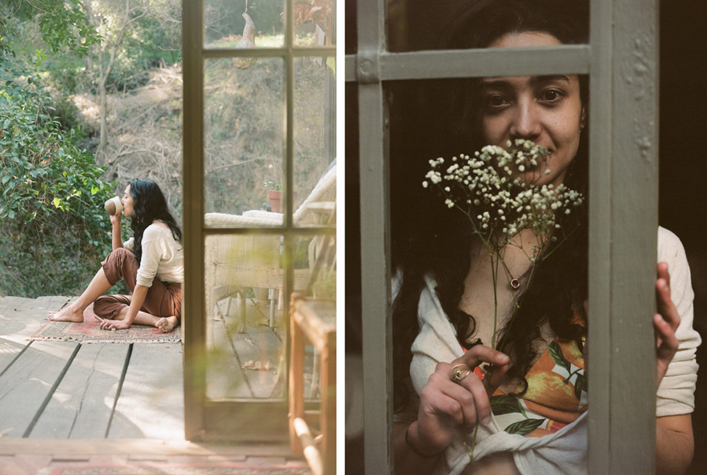 young woman smelling flowers and drinking tea